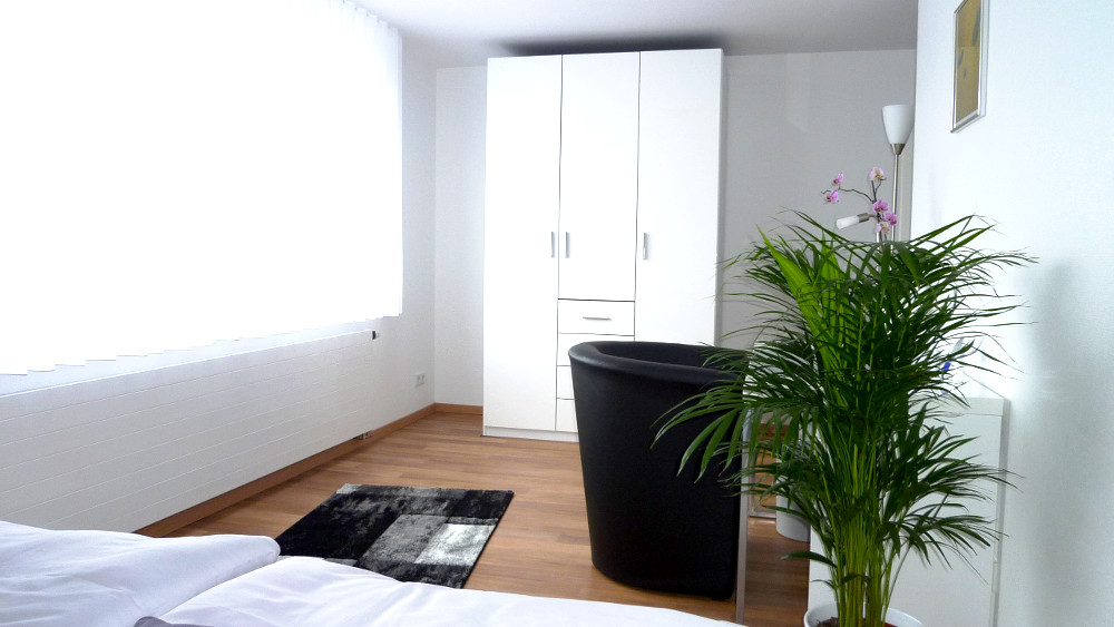 Double room with desk and large wardrobe